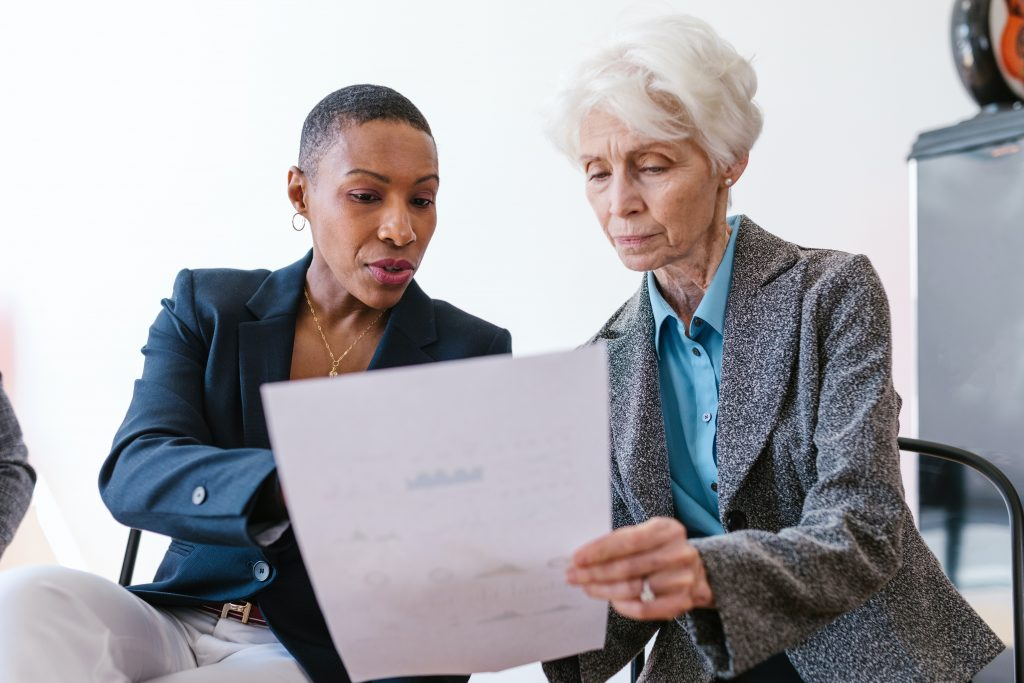 How to write a proposal for investors image two women reading paper